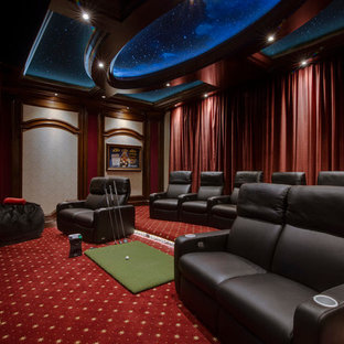 Elegant enclosed carpeted and multicolored floor home theater photo in Orlando