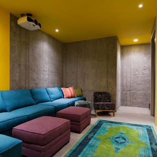 Contemporary home theatre in Salt Lake City with concrete floors and a projector screen.