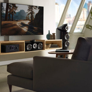 Modern open concept home theatre in Boston with beige walls, ceramic floors, a wall-mounted tv and beige floor.