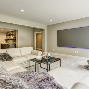 Inspiration for a transitional open concept carpeted and gray floor home theater remodel in Other with gray walls and a projector screen