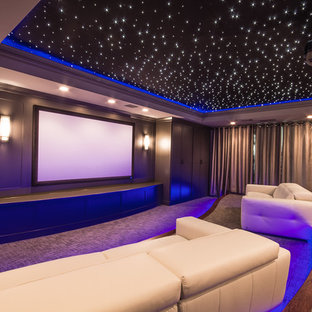 Home theater - large contemporary enclosed carpeted and gray floor home theater idea in Atlanta with gray walls and a projector screen