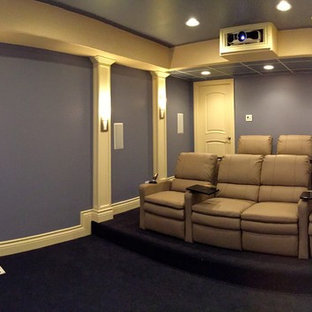 Design ideas for a mid-sized traditional enclosed home theatre in Chicago with purple walls, carpet and a projector screen.