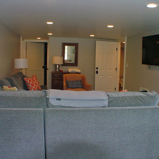 Mid-sized traditional enclosed home theatre in Portland Maine with slate floors and a wall-mounted tv.