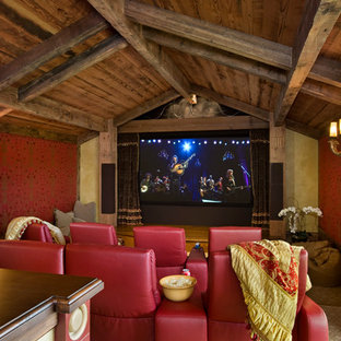 Home theater - rustic home theater idea in Other with red walls