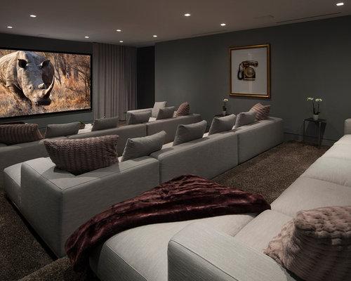 foto e idee per home theatre home theatre con pareti grigie. Black Bedroom Furniture Sets. Home Design Ideas