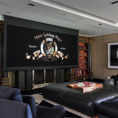 Home theater - huge traditional open concept carpeted and black floor home theater idea in Los Angeles with beige walls and a media wall