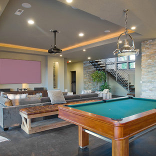 Inspiration for a contemporary gray floor home theater remodel in Portland with gray walls