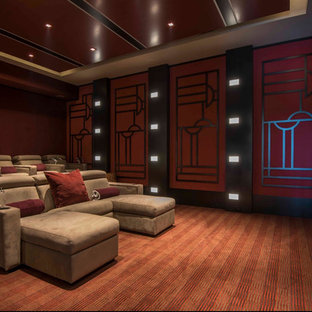 Design ideas for a large contemporary enclosed home cinema in Miami with red walls, carpet, a projector screen and red floors.