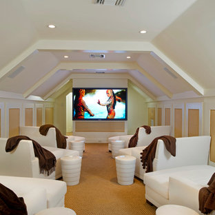 Large island style enclosed carpeted home theater photo in Orlando with white walls and a wall-mounted tv
