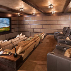 Rustic Home Theater by North Fork Builders of Montana, Inc.