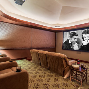Large island style enclosed carpeted home theater photo in Hawaii with a projector screen