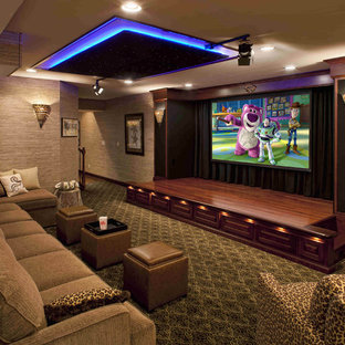 Design ideas for a large traditional open concept home theatre in Philadelphia with carpet, a projector screen, multi-coloured floor and grey walls.