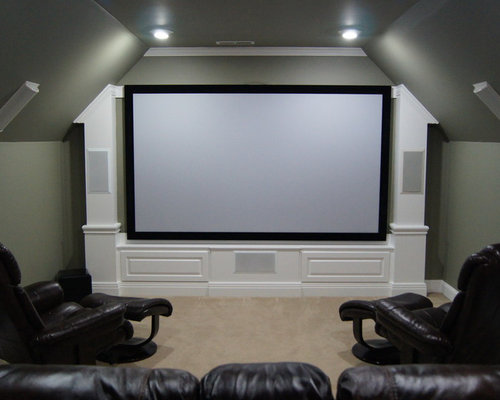 small trendy enclosed carpeted home theater photo in other with gray walls and a projector screen