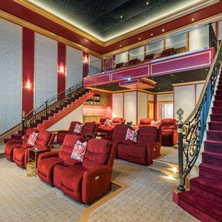 Example of a tuscan enclosed multicolored floor home theater design in Miami with red walls