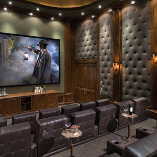 Elegant home theater photo in Los Angeles with green walls