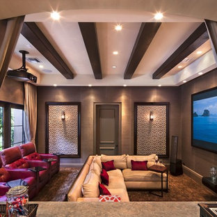Medium sized traditional open plan home cinema with multi-coloured walls, concrete flooring and a projector screen.