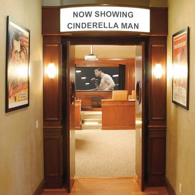 Inspiration for a mid-sized timeless enclosed carpeted home theater remodel in Other with brown walls and a projector screen