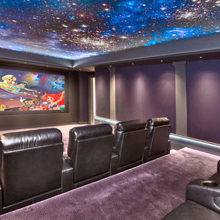 Example of a transitional enclosed carpeted and purple floor home theater design in New York with purple walls and a projector screen