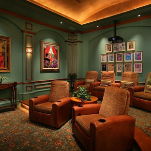 Mediterranean home cinema in Miami with green walls.