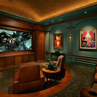 Example of a tuscan enclosed carpeted and multicolored floor home theater design in Miami with green walls and a media wall