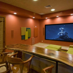 Large contemporary enclosed home theatre in Hawaii with orange walls, carpet and a projector screen.