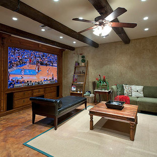 Photo of a large enclosed home theatre in Miami with beige walls, concrete floors, a projector screen and brown floor.