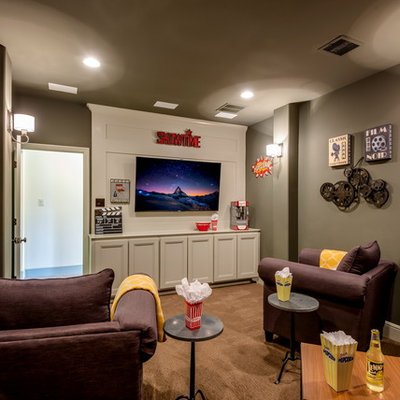 Elegant enclosed carpeted and brown floor home theater photo in Austin with gray walls and a wall-mounted tv