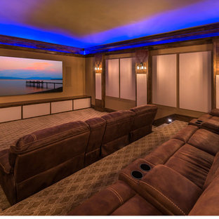Large mountain style enclosed carpeted home theater photo in Other with yellow walls and a wall-mounted tv