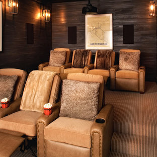 Inspiration for a rustic carpeted and brown floor home theater remodel in Atlanta with brown walls
