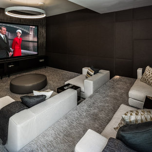 Inspiration for a contemporary enclosed carpeted and gray floor home theater remodel in Los Angeles with black walls