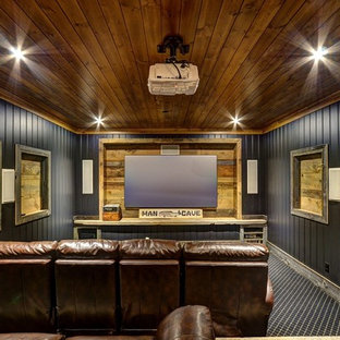 Home theater - rustic enclosed carpeted home theater idea in Toronto with black walls and a projector screen