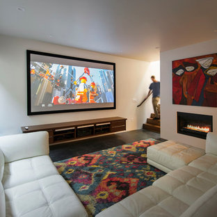 Inspiration for a mid-sized modern open concept home theatre in Salt Lake City with white walls, concrete floors and a projector screen.