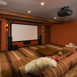 Large Mountain Style Enclosed Carpeted And Multicolored Floor Home Theater  Photo In Other With Red Walls