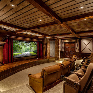 Home theater - rustic enclosed carpeted and beige floor home theater idea in Charlotte with a media wall and white walls