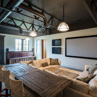 Example of a mountain style concrete floor and gray floor home theater design in Nashville with a projector screen