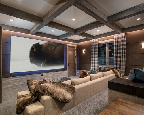 example of a mountain style carpeted and gray floor home theater design in other with brown