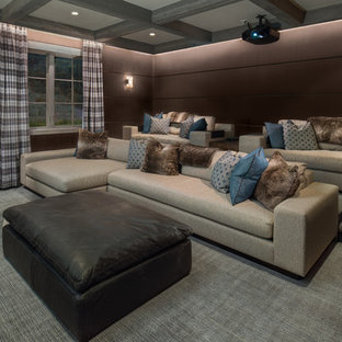 Inspiration for a rustic enclosed carpeted and gray floor home theater remodel in Other with brown walls