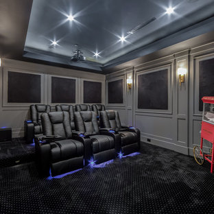 Transitional enclosed carpeted and black floor home theater photo in Los Angeles with gray walls