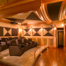 Tropical Home Theater by Lancaster Interior Design