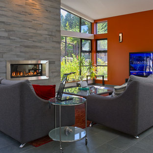 Mid-sized contemporary home theatre in Vancouver with multi-coloured walls, slate floors and a wall-mounted tv.