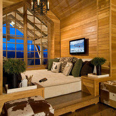 Rustic Home Theater by AMBIANCE SYSTEMS