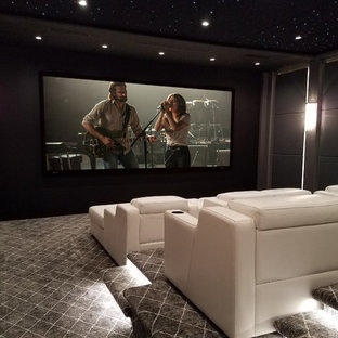 Example Of A Trendy Enclosed Carpeted And Gray Floor Home Theater Design In New York With
