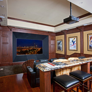 Home theater - traditional brown floor home theater idea in Charlotte with a projector screen