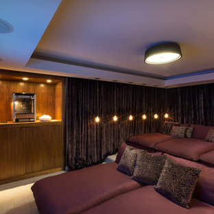 Inspiration for a mid-sized contemporary enclosed home theater remodel in Miami with a wall-mounted tv
