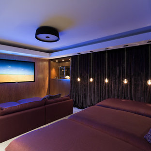 Home theater - mid-sized contemporary enclosed home theater idea in Miami with a wall-mounted tv