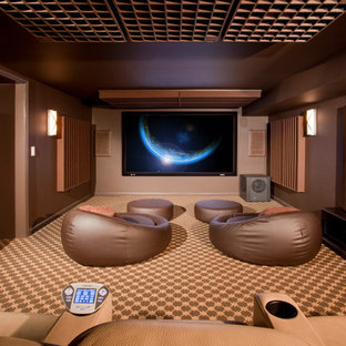 Inspiration for a mid-sized modern enclosed carpeted and multicolored floor home theater remodel in Newark with brown walls and a wall-mounted tv