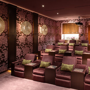 Design ideas for a large asian enclosed home theatre in Orange County with purple walls, carpet, purple floor and a projector screen.