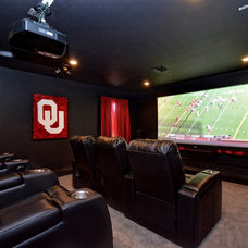 Eclectic Home Theater by Spindle Design Co.