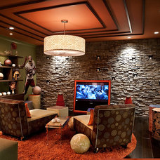 Eclectic Home Theater by Designing Solutions