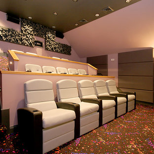 Design ideas for a large traditional enclosed home theatre in Chicago with pink walls, carpet and a projector screen.